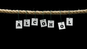 Tags with black letters forming the word alcohol Stock Images