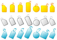 Tags and bows. Tags with different colors and shapes over white background Royalty Free Stock Photo