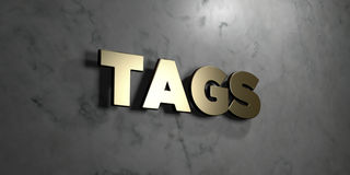 Tags - Gold sign mounted on glossy marble wall  - 3D rendered royalty free stock illustration Royalty Free Stock Photos