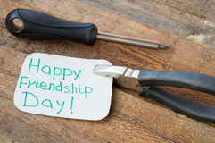 Tags happy friendship day and tools on the old wooden background Stock Images