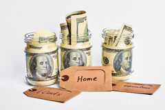 Tags and jars with dollars. Stock Image