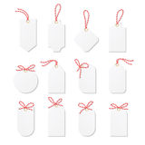 Tags and labels with bakers twine bows ribbons Stock Images