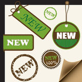 Tags with new sign. Set of tags, ribbons and stamps with NEW sign Stock Image