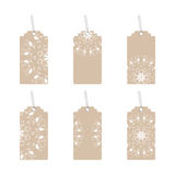 Tags with an ornament beige. Set of six labels with ornament Royalty Free Stock Images