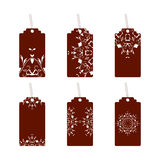 Tags with ornaments maroon. Set of six labels with ornament Stock Photos