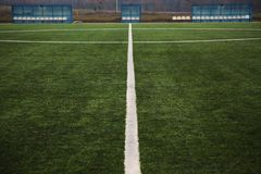 Football field lines. Tags on soccer field, white lines and grass Royalty Free Stock Photo