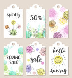 Tags for spring sale. Set of hand drawn tags for spring sale with watercolor textures and flowers Royalty Free Stock Photos