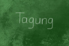 Tagung written on a blackboard Royalty Free Stock Image