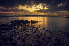 Tagus Evening. View of Tagus river and 25 of April bridge in Lisbon in the evening Royalty Free Stock Image