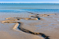 Tagus river bottom and Vasco da Gama Bridge as background Stock Photography