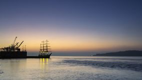 Tagus river, cranes and ship. Cranes and ship at Tagus river in a foggy dawn Royalty Free Stock Photo