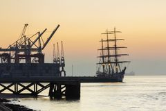 Tagus river, cranes and ship. Cranes and ship at Tagus river in a foggy dawn Stock Photography