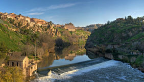 The Tagus River flows through Toledo, Spain. The Tagus River, the longest river on the Iberian Peninsula at 1,038 kilometers, begins its journey in the Albarrac Royalty Free Stock Image
