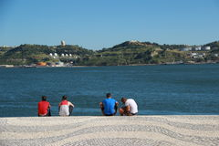 Tagus river , Lisbon. Four mens with Tagus river in background Lisbon - Portugal Stock Photo