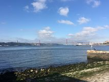 Tagus river. With the Ponte 25 Abril and Christ the King statue in Lisbon Portugal Stock Photo