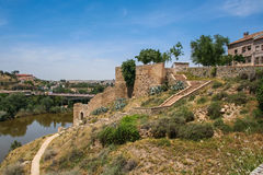 The Tagus river. The slopes of the Tagus river , the view near the bridge of St. Martin in Toledo, Spain. May 2006 Royalty Free Stock Images
