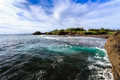 Tahah Lot Temple and ocean waves, Bali Stock Photos