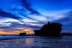 Tahah Lot Temple and ocean waves at sunset, Bali Royalty Free Stock Photos