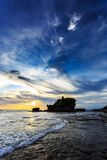Tahah Lot Temple and ocean waves at sunset, Bali Stock Images