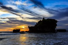 Tahah Lot Temple and ocean waves at sunset, Bali Royalty Free Stock Image