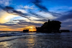 Tahah Lot Temple and ocean waves at sunset, Bali Stock Photos