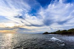 Tahah Lot Temple and ocean waves at sunset, Bali Stock Photography