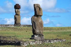 Tahai Ceremonial Complex archaeological site Rapa Nui - Easter Island. Tahai Ceremonial Complex, Easter Island, Giant stone statues Moai standing upon ceremonial royalty free stock photo