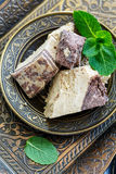 Tahini halva with chocolate and mint in a bronze plate. stock photo