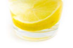 Tahiti Lemon slices under water on white background Royalty Free Stock Photos