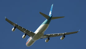 Tahiti Nui A340. A Tahiti Nui Airways Airbus in flight, set against azure blue sky Royalty Free Stock Photo