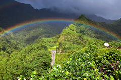 Tahiti. Polynesia. Clouds over a mountain landscape and rainbow. Tahiti. Polynesia. Clouds over  mountain landscape and rainbow Royalty Free Stock Image