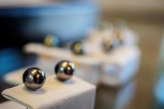 Tahitian black pearl earrings Stock Photography