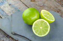 Tahitian limes on a stone . Stock Image
