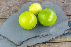 Tahitian limes on a stone . Royalty Free Stock Photo
