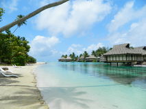 Tahitian Paradise. Bungalows over the turquoise waters of Tahiti's Morea Island Stock Image