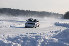TAHKO, FINLAND - FEBRUARY 23, 2010: A racing car BMW in motion at the winter rally in Tahko, Finland royalty free stock photos