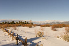 Tahoe Coast. Open field of snow with the mountains of Tahoe behind Stock Photo