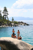 Tahoe Swimming Cove. Boys on Rock at lake Tahoe stock photos
