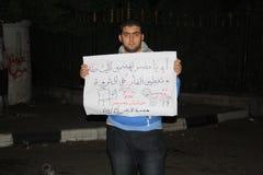 tahrir的人们在埃及革命时摆正 图库摄影