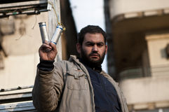 Tahrir protester. Cairo, an young protester shows the cartridge used by police during fighting in the main square Royalty Free Stock Photos