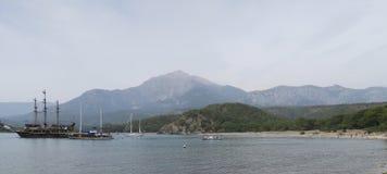 Tahtali Dagi - Olympos - Mountain and Sailing Ships, as seen from the Coast in Tekirova, Kemer, Turkey Stock Images