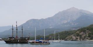 Tahtali Dagi - Olympos - Mountain and Sailing Ships, as seen from the Coast in Tekirova, Kemer, Turkey Royalty Free Stock Photo