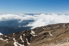 Tahtali mountain. View of the top of Tahtali mountain over white clouds Stock Image