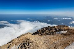 Tahtali mountain. View of the top of Tahtali mountain over white clouds Royalty Free Stock Image