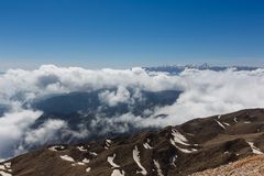 Tahtali mountain. View of the top of Tahtali mountain over white clouds Stock Images