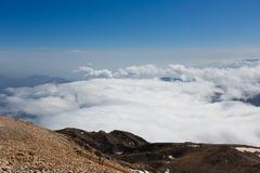 Tahtali mountain. View of the top of Tahtali mountain over white clouds Royalty Free Stock Images