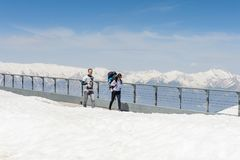 People on the Tahtali mountain. TAHTALI, TURKEY - APR 20, 2015: Unidentified tourists on the top of the Tahtali mountain. Tahtali mountain is 2365m high Royalty Free Stock Images