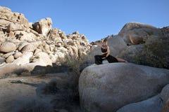 Tai Chi. Yin and Yang: Yin-darkness Yang-Light. Wide desert landscape with beautiful woman doing tai chi on the boulders Royalty Free Stock Image