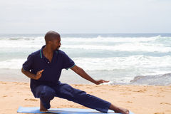 Tai chi. Young african american man doing tai chi exercise on beach royalty free stock photos