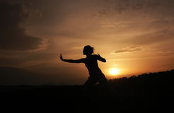 Tai chi. Photo of a woman...meditation tai chi Royalty Free Stock Images